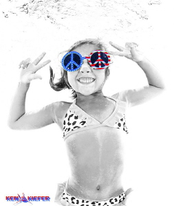 My niece goofing around underwater in the pool.   She's j... by Ken Kiefer